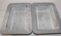 "our into two lightly greased and floured 9x5"" loaf pans."